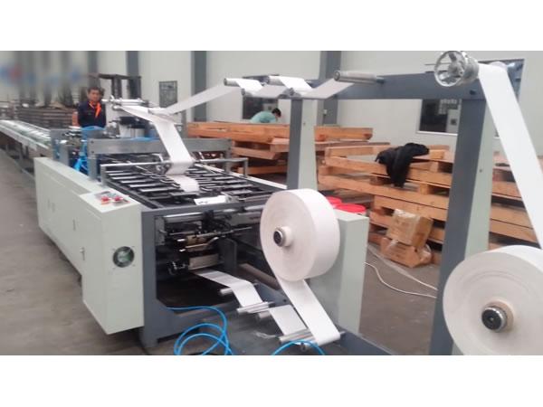 Machine pour la transformation du papier (pour fabrication d'anses de sacs en papier ...